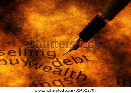 Fountain pen on debt text - stock photo