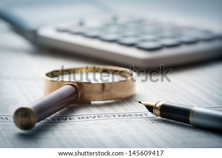 Fountain pen on financial newspaper  - stock photo