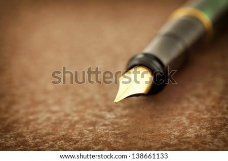 Fountain pen on iron - stock photo