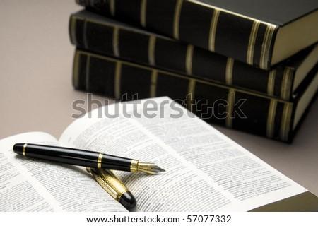 fountain pen on open book - stock photo