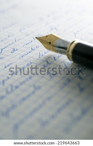 fountain pen over old letters. - stock photo