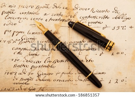 Fountain pen with cap on an antique  letter - stock photo