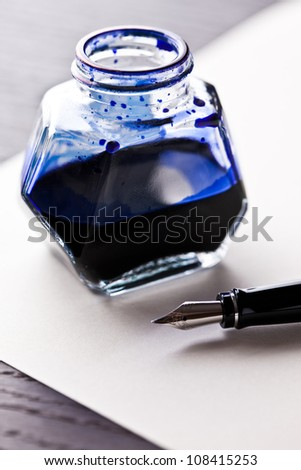 fountain pen with ink bottle - stock photo