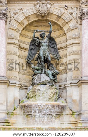 Fountain Saint-Michel at Place Saint-Michel in Paris, France. It was constructed in 1858-1860 during French Second Empire by architect Gabriel Davioud. Archangel Michael and devil by Francisque Duret. - stock photo