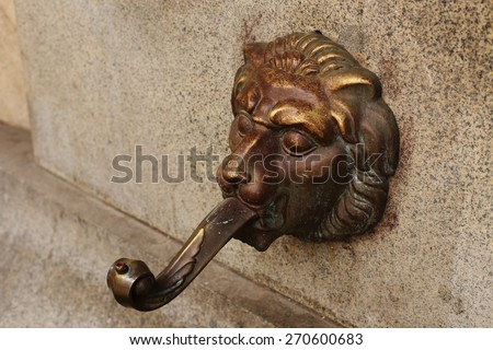 fountain with a lion's head close up - stock photo