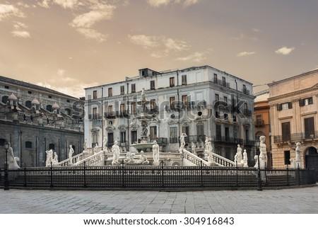 Fountain with sculptures, adorning Fountain Pretoria on Piazza Pretoria. Palermo, Sicily, Italy  - stock photo