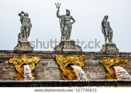 Fountain with statues in the Peterhof Palace complex. Saint Petersburg region, Russia. - stock photo