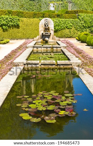 Fountain with water lily leaves in Palacio de Cristal Gardens, Porto, Portugal. - stock photo