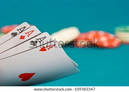 four ace and chips on a green felt - stock photo
