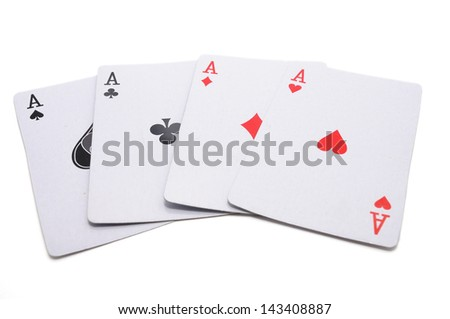 Four aces, including spades, hearts, clubs and diamonds isolated on white background. - stock photo