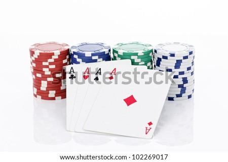 Four aces of a kind and chips - stock photo