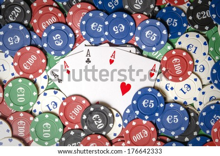 Four aces on casino chips seen from above - stock photo
