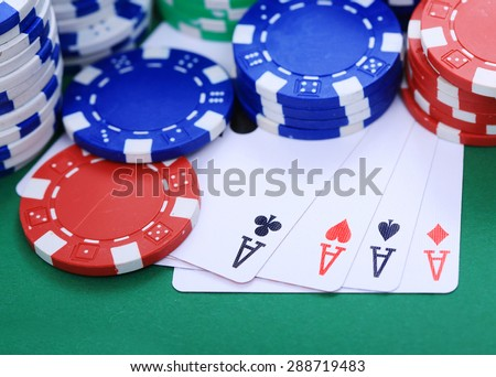 Four aces with colorful token - stock photo