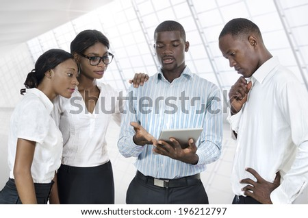 Four african business people with tablet PC, Studio Shot - stock photo