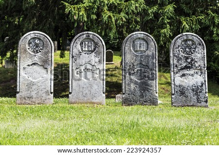 Four Antique Gravestones - stock photo