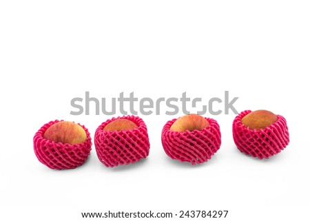 four apple with foam protection net on isolated white background - stock photo