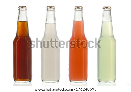 Four assorted soda bottles, non-alcoholic drinks with water drops - stock photo