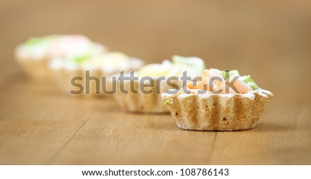 four baskets dessert sweet cream sprinkled powdered sugar background wooden table - stock photo