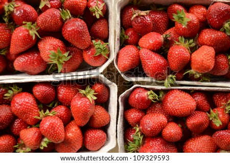 Four Baskets Of Fresh Strawberries In A Street Market - stock photo