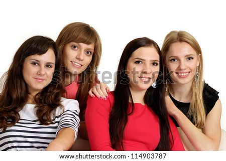 Four beautiful young girl on light background - stock photo