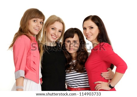 Four beautiful young girl posing on light background - stock photo