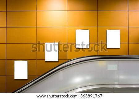 Four big vertical / portrait orientation blank billboard with escalator background - stock photo