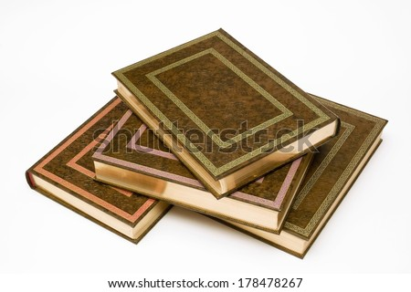 four books stacked bound with valuable covers and gold tooling - stock photo