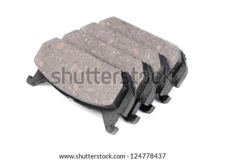 four brake pads, isolatet on white - stock photo