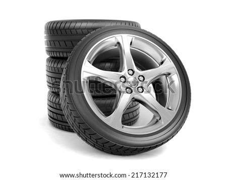 Four brand new tires stacked ready for use, isolated on white background - stock photo