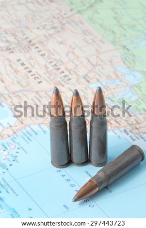 Four bullets on the geographical map of United States of America. Conceptual image for war, conflict, violence. - stock photo