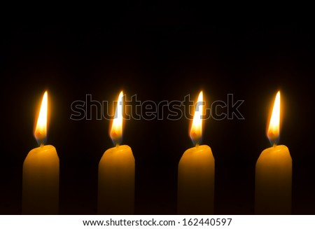 Four burning candles for Advent - Christmas - stock photo