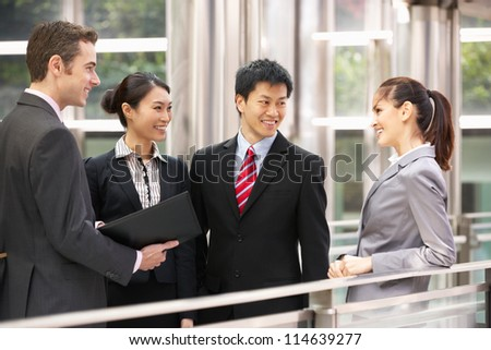 Four Business Colleagues Having Discussion Outside Office - stock photo