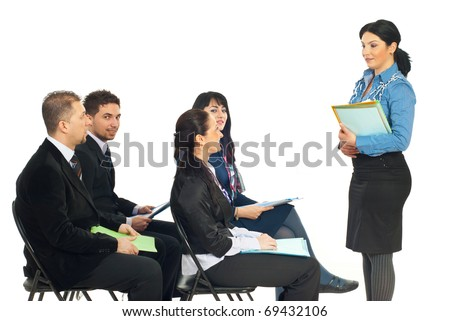 Four business people at training seminar with teacher making conversation with one of the business woman  isolated on white background - stock photo