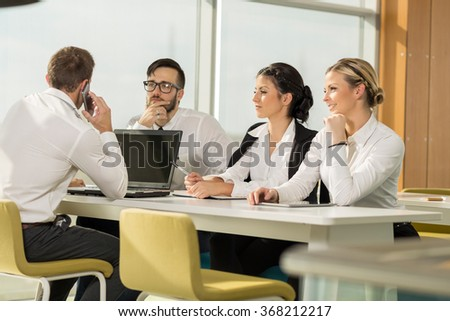 Four business people on a meeting in a conference room - stock photo