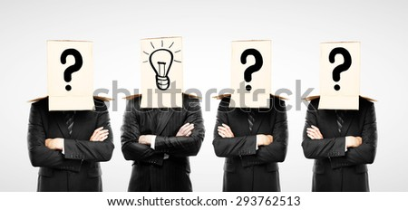four businessman with box and lamp on hand - stock photo