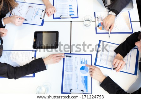 Four businesspeople discussing in a meeting in the office - stock photo
