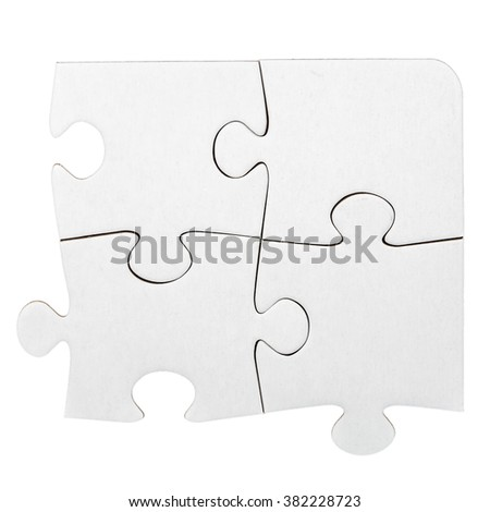 Four cardboard jigsaw puzzle pieces isolated on white - stock photo