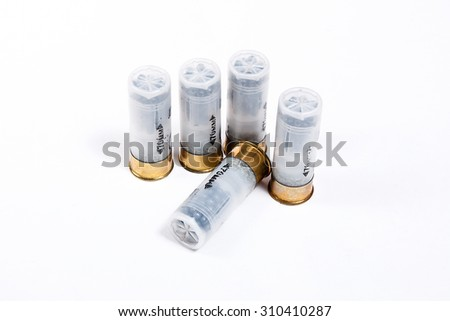 Four cartridges for hunting gun isolated on white. - stock photo
