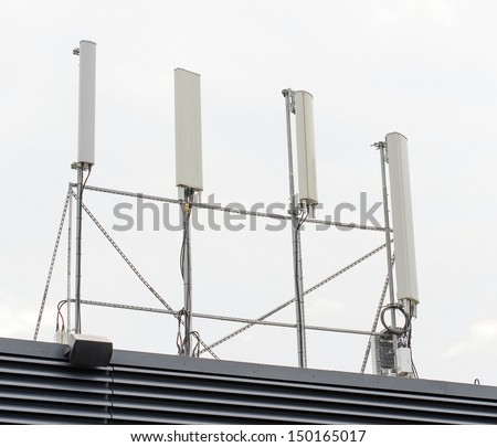 Four cellular towers on the roof - stock photo