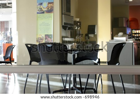 Four Chairs and the Empty Cafeteria - stock photo