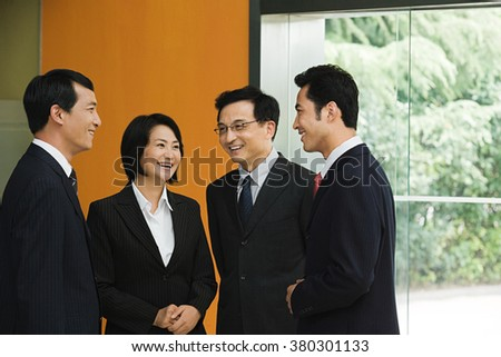 Four Chinese business colleagues - stock photo