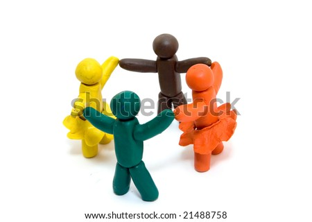 Four clay human figures isolated on white background - stock photo