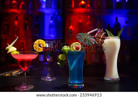 Four cocktails on the bar counter - stock photo