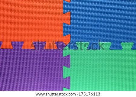 four color fields with pieces of puzzle - stock photo