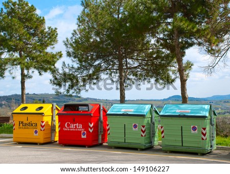 Four color trash cans (garbage bins) - stock photo
