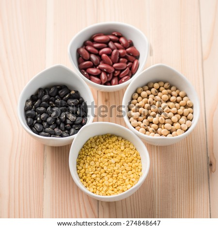 four colored beans in ceramic bowl - stock photo