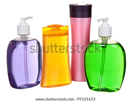 four colored plastic bottles with liquid soap and shower gel isolated on white background - stock photo