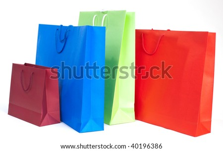 Four colorful gift paper bags on white background - stock photo
