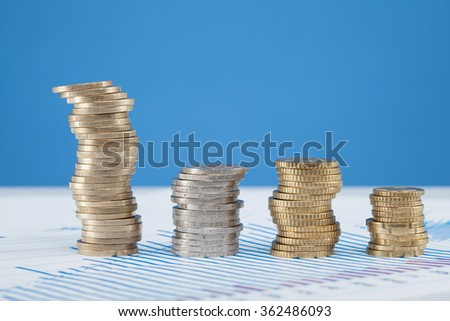 Four columns of coins on the table, closeup shot - stock photo
