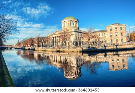Four courts building in Dublin, Ireland with river Liffey - stock photo